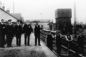 Curriehill Railway Station. Robert Brown, Station Master, second from the left, 1918.