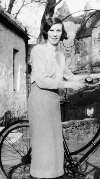 Bella Steel, Ladycroft, Balerno with Malleny House in the background, 1920s.